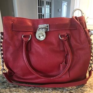 Red Michael Kors Bag. Never been used.
